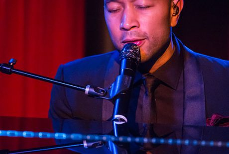A picture of John Legend at a piano